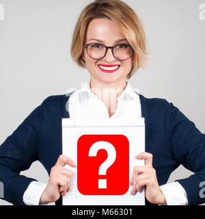 Beautiful business woman holding blank paper with question mark - Stock Photo