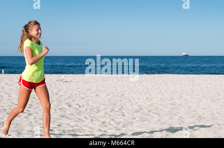 Running woman. Female runner jogging during outdoor workout on beach. Fitness female doing running exercise on seashore. - Stock Photo