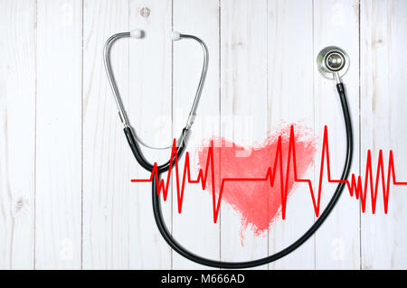 Medical stethoscope and red heart with cardiogram on desk. Health Concepts - Stock Photo
