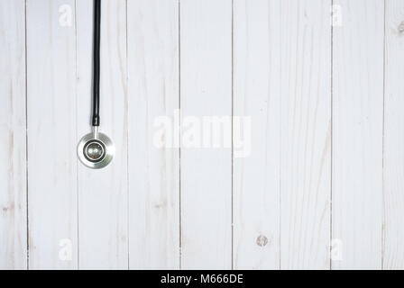 Medical stethoscope on white desk. Medicine concept - Stock Photo