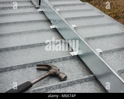 The barrier for snow guard on the edge of a metal roof - Stock Photo