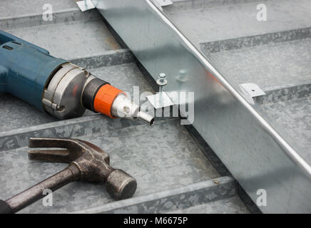 It made a barrier to the snow guard on the metal roof - Stock Photo