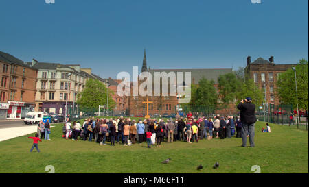 open air good Friday service with cross Easter Partick, Glasgow, UK - Stock Photo