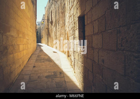 Narrow streets of the old Mdina. Typical architecture in Malta - Stock Photo