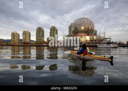 Downtown Vancouver, British Columbia, Canada - January 28, 2017 - Woman Kayaking near Science World in False Creek - Stock Photo