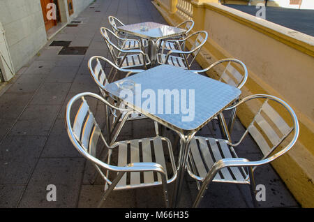 Steel table and chairs in street cafe, Spain - Stock Photo