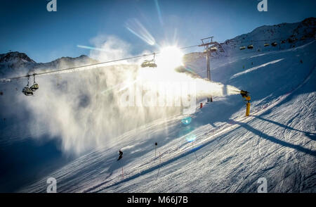 Skiing at sunset in Alpine ski resort . Artistic HDR image. - Stock Photo
