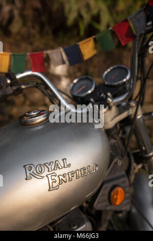 Meghalaya, India - May 8, 2017: Legendary Royal Enfield Thunderbird motorbike. Close-up view at a fuel tank with - Stock Photo