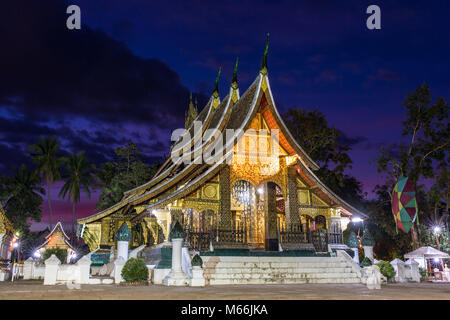 Wat Xieng Thong temple at night in Luang Prabang, Laos - Stock Photo