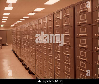 1950s 1960s LONG ROW OF GREEN GRAY METAL FILE CABINETS ON CASTERS DATA STORAGE SYSTEM ORGANIZATION - ko434 HAR001 - Stock Photo