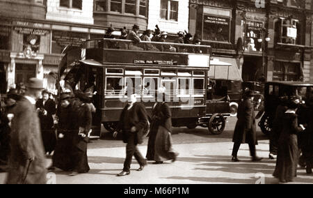 1900s TURN OF 20TH CENTURY NEW YORK CITY MANHATTAN PEDESTRIANS TRAFFIC CARS DOUBLE DECKER BUS FIFTH AVENUE URBAN - Stock Photo