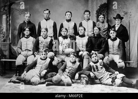 1800s 1890s GROUP PORTRAIT HIGH SCHOOL FOOTBALL TEAM PLAYERS WEARING TEAM UNIFORMS LOOKING AT CAMERA - o3703 LEF001 - Stock Photo