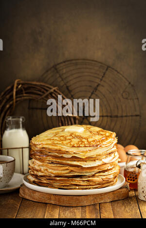 Big stack of homemade crepes or thin crepes - Stock Photo