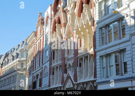 LONDON, UK – FEBRUARY 25, 2018:  Colorful facades of buildings on Eastcheap Street in the financial district of - Stock Photo