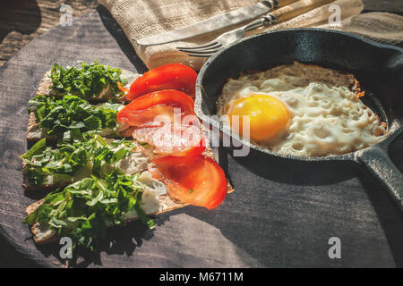 A healthy country Breakfast of scrambled eggs in a round pan and crispy breads with soft ricotta cheese and fresh - Stock Photo