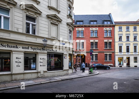 Berlin Mitte, Urban street view, Sophieneck corner restaurant, historic old apartment buildings & entrance to St. - Stock Photo