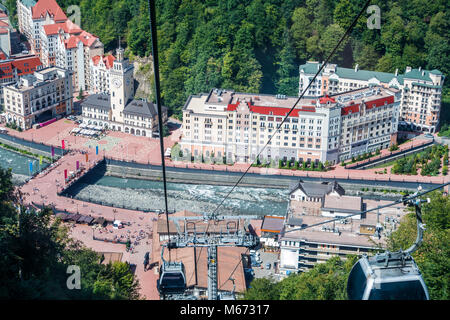 Photos of buildings, funicular, river at foot of mountains - Stock Photo