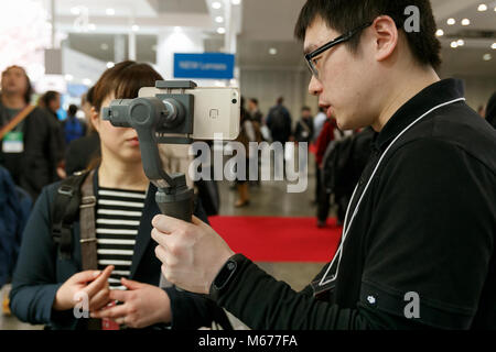 Yokohama, Japan. 1st Mar, 2018. An exhibitor gives a demonstration of the new DJI OSMO MOBILE 2 at the CP  Camera - Stock Photo