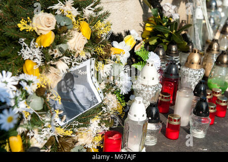 Flowers and candles are seen in front of the residence of murdered Slovak journalist Jan Kuciak in Velka Maca, Slovakia, - Stock Photo