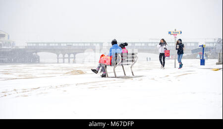 Bournemouth; UK; 1 March 2018. Enjoying the unusual sight of snow on the beach at Bournemouth as the so called 'Beast - Stock Photo