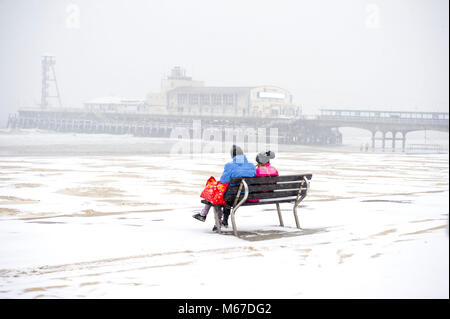 Bournemouth, UK, 1 March 2018. Enjoying the unusual sight of snow on the beach at Bournemouth as the so called 'Beast - Stock Photo