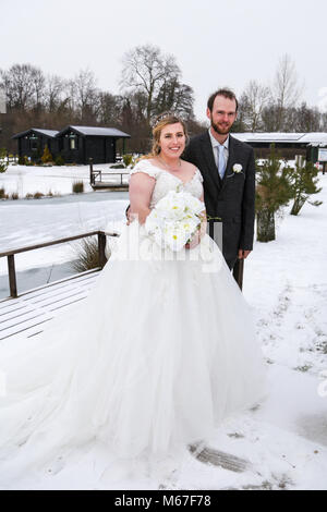 Henlow Bridge Lakes, Bedfordshire, UK, 1st March 2018. Canadian, Mathew Main, from Manitoba and his bride Mary Winson - Stock Photo