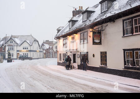 The Crown pub on snow covered Fordingbridge High Street, New Forest, Hampshire, England, UK, March 2018 during Storm - Stock Photo