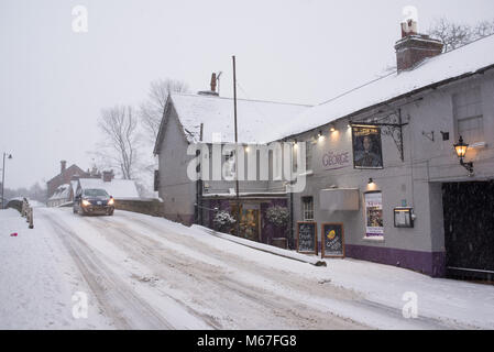 Snow covered streets making walking and driving hazardous in the town centre of Fordingbridge, New Forest, Hampshire, - Stock Photo