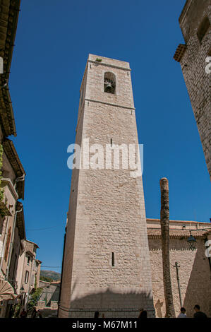 View of stone steeple tower next to church in Saint-Paul-de-Vence, a well preserved medieval hamlet near Nice. Provence - Stock Photo