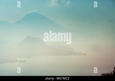 Beautiful lake Atitlan and volcanos in the highlands of Guatemala, Central America - Stock Photo