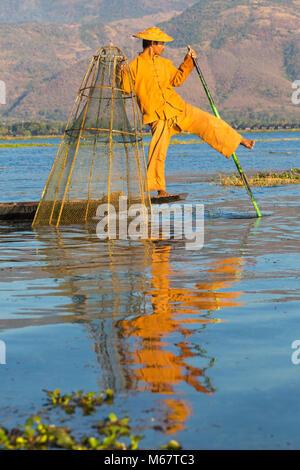 Intha leg rowing fishermen at Inle Lake, Shan State, Myanmar (Burma), Asia in February - fisherman using foot on - Stock Photo