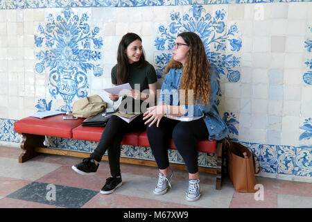 Two female University students, Universidade de Coimbra / University of Coimbra, Coimbra, Portugal - Stock Photo