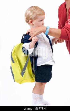 Happy little schoolgirl. Child with backpack and books. Preschool go to school. - Stock Photo
