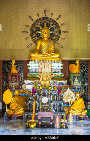 Buddhist altar in the monastery. - Stock Photo