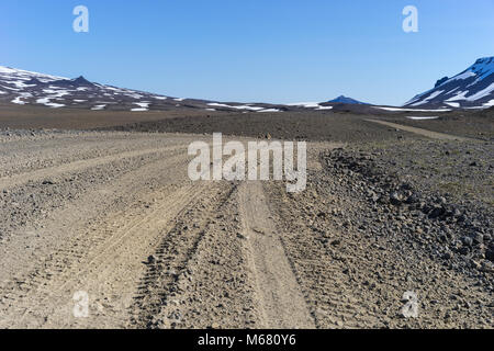 Four Wheel Drive Mountain Track through the Western Icelandic Highlands on a clear sunny day - Stock Photo