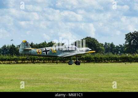 A Messerschmitt Bf 108 taking off at Old Sarum Airfield, Wiltshire, UK - Stock Photo