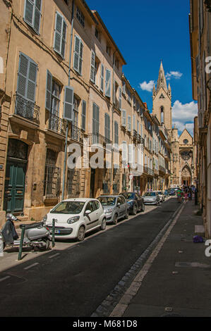 Street with buildings and Saint Jean de Malte Church in Aix-en-Provence, a lively town in the countryside. Provence - Stock Photo