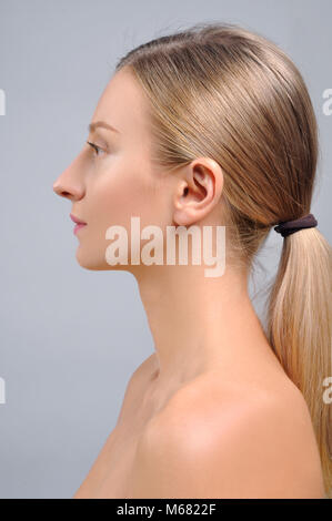 Portrait of female profile face. Plastic surgery. Anti-aging treatment and face lift. - Stock Photo
