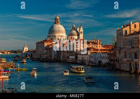 Looking out towards Venice's iconic Santa Marie della Salute church from the Accademia Bridge - Stock Photo