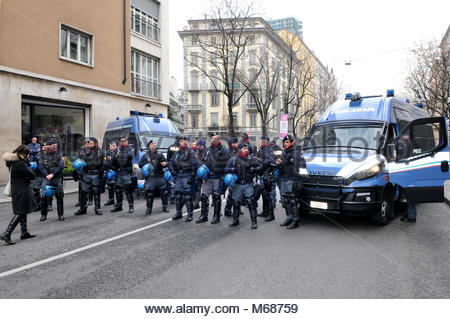 police officers in riot gear get ready before the demonstrators' march in Milan Stock Photo