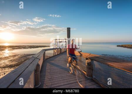 Lignano Sabbiadoro, Province of Udine, Friuli-Venezia Giulia, Italy. Sunset over lagoon of Lignano Sabbiadoro - Stock Photo