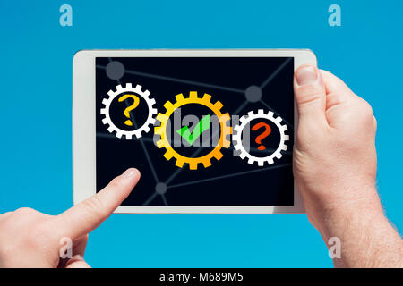 Man holding a tablet device showing think, success concept in blue background. - Stock Photo