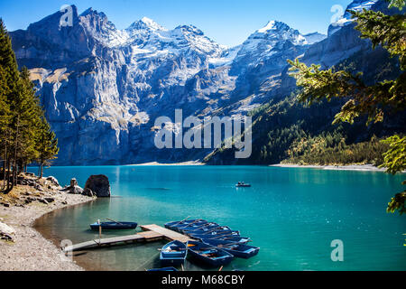 scenic view of famous mountain lake oeschinensee in switzerland kandersteg late summer in the alps with snow covered - Stock Photo