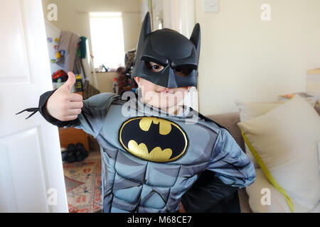 A young boy dressed up in a batman super hero costume. - Stock Photo