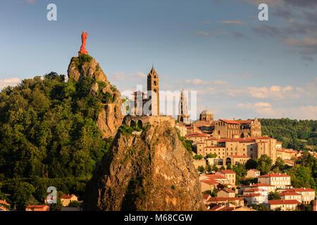 Statue of Notre Dame de France  with Saint Michel d'Aiguilhe Chapel and Notre Dame Cathedral Le Puy en Velay Haute - Stock Photo
