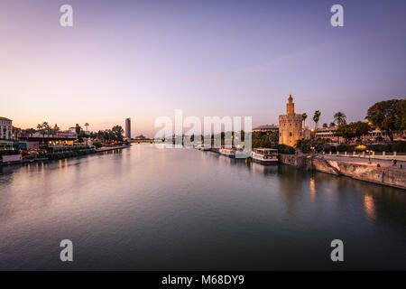 Blue Hour view Golden tower or Torre del Oro along the Guadalquivir river, Seville, Andalusia, Spain. - Stock Photo