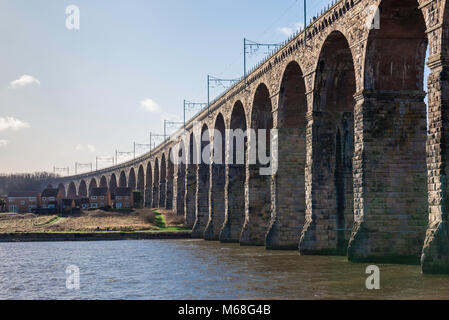 View of the Royal Border Bridge designed by Robert Stephenson (1850) spanning the Tweed near the border town of - Stock Photo