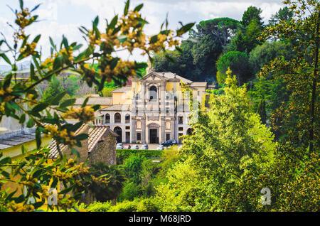 Caprarola - Viterbo - Italy - The Santa Teresa church through the tree branches - Stock Photo