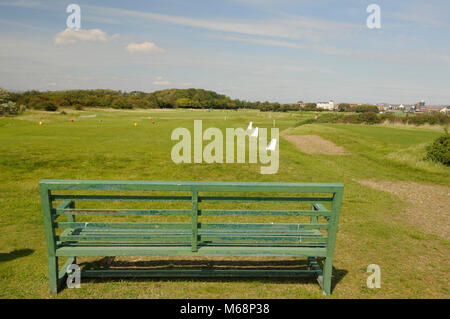 View over bench to 14th Tee and fairway, Littlehampton Golf course, Littlehampton, Sussex, England - Stock Photo