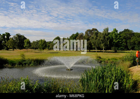 View from the 12th Tee over pond with Fountain to 12th and 1st Fairways; Langley Park Golf Club, Beckenham, Kent, - Stock Photo